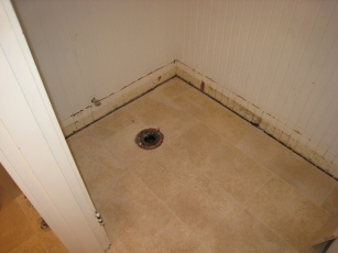 Toilet location in limestone tiles